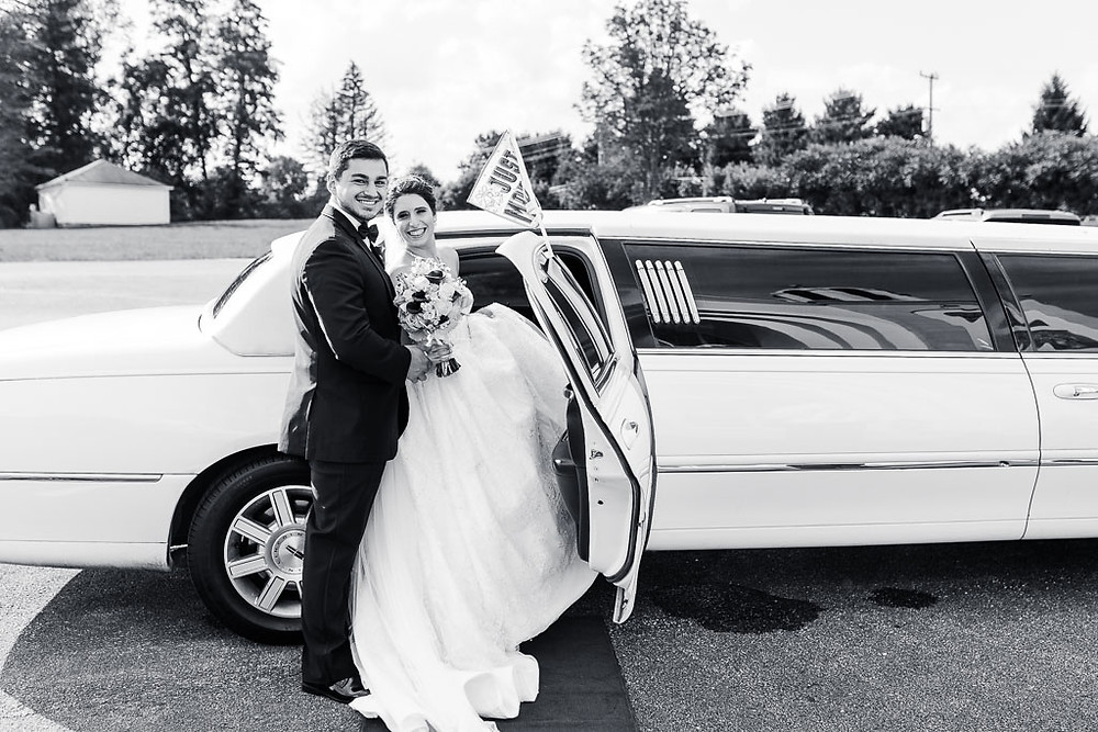 bride and groom getting into the limo baltimore wedding photography black and white