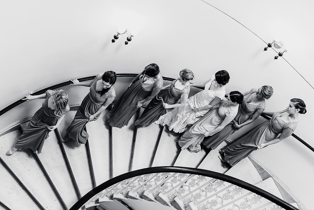 bridesmaids walking down stairs black and white