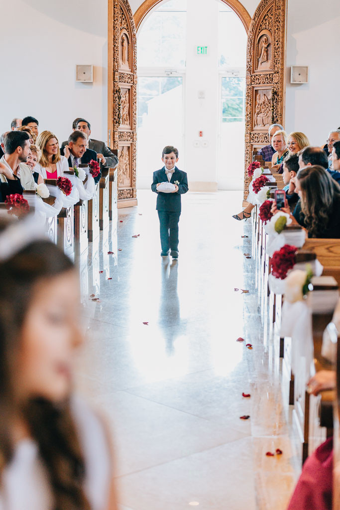the cutest little ring bearer with bow tie