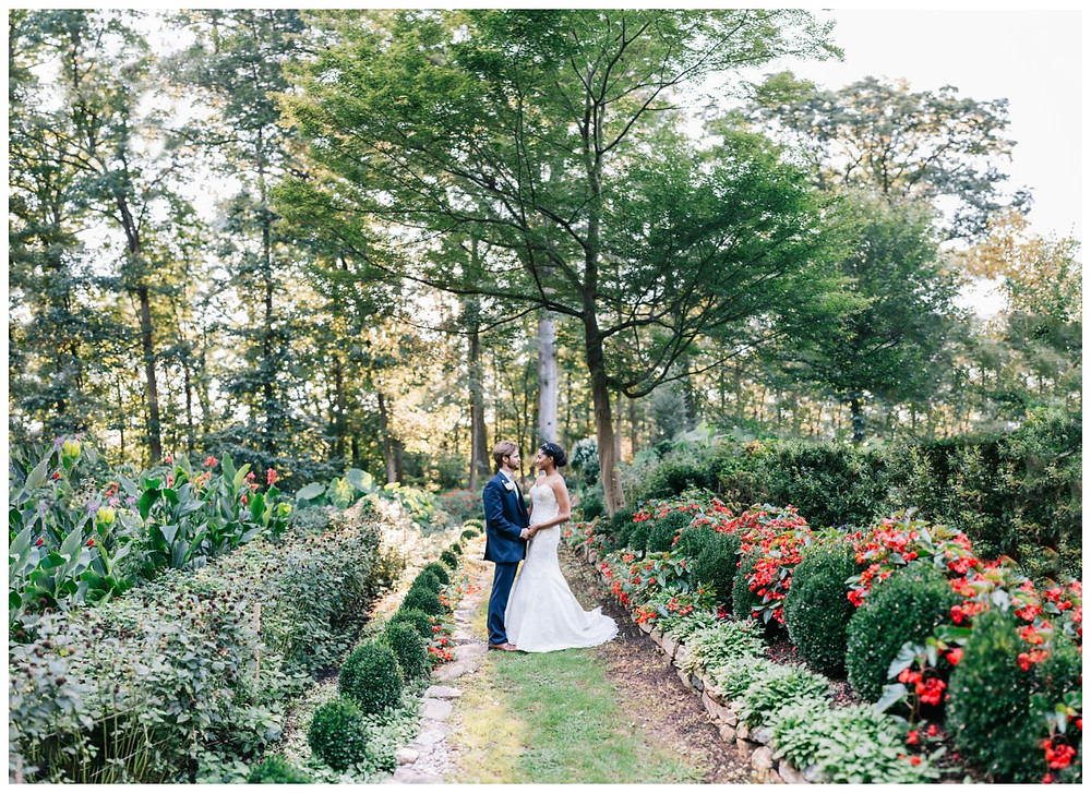 Brenizer style portrait of the bride and groom in the gardens at Gramercy Mansion