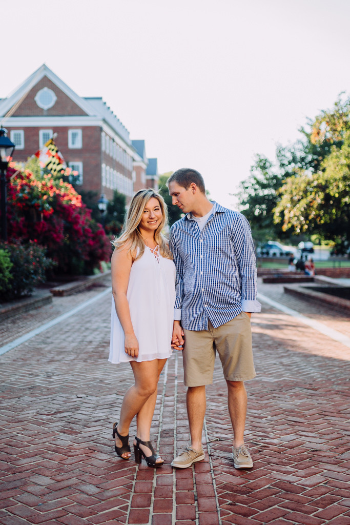 Red Brick Streets and him looking at her - downtown Annapolis engagement