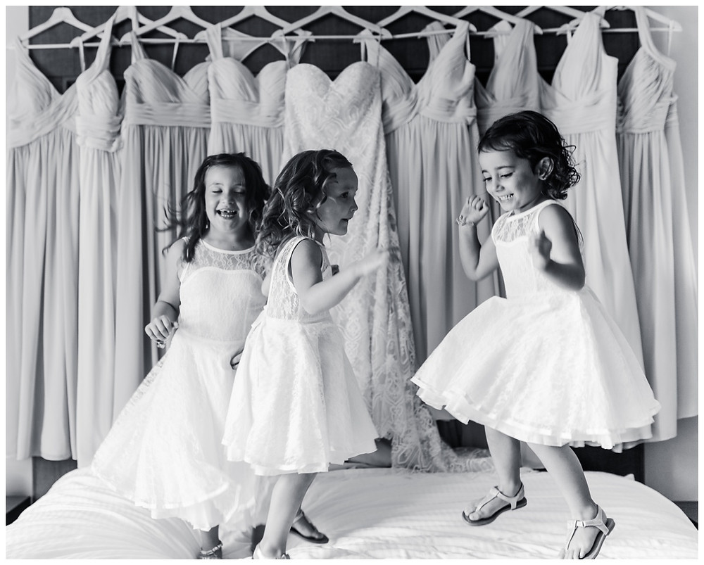 Flower Girls jumping on the bed at Liberty Mountain Resort