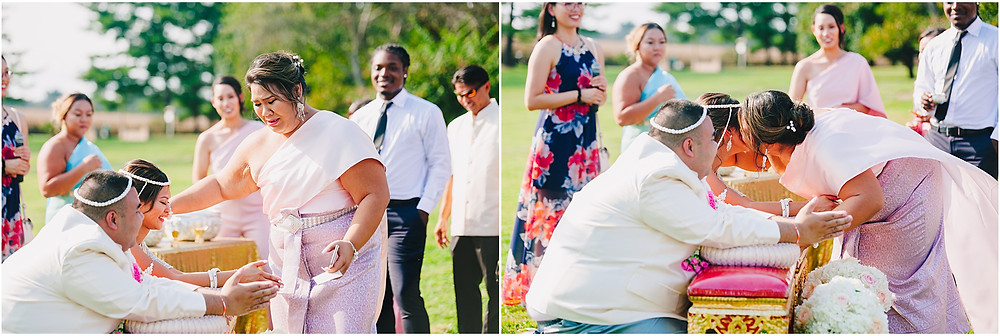 Emotional moment during Thai watering ceremony at Sylvanside Farm Wedding