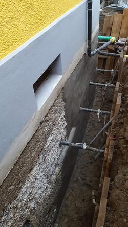 Grabenaushub und Instandstellung der Wand