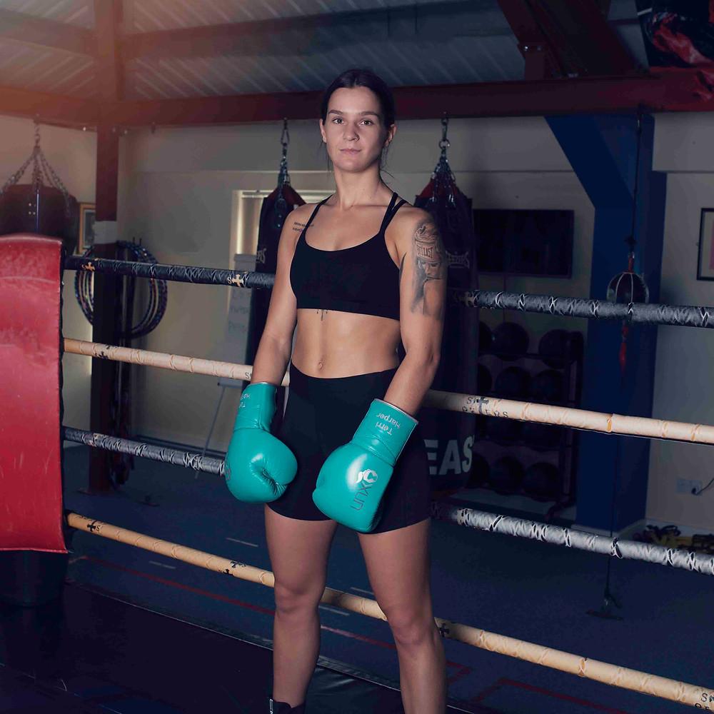 Terri Harper wearing Unorthodoxx's Harper Elite Women's boxing gloves