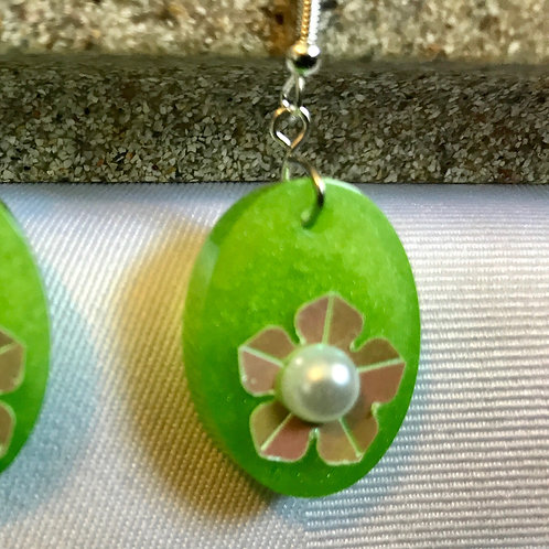 Metallic Flower on Green Resin Oval earrings