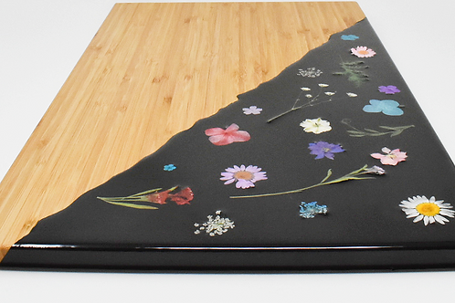 Colorful flowers charcuterie board front view