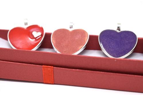 Assorted Resin Heart pendants on metal bezels front view