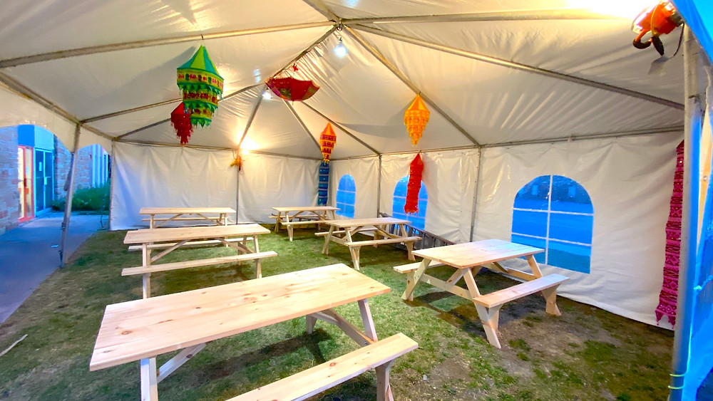 Outdoor dining inside covered Tent at Avsar