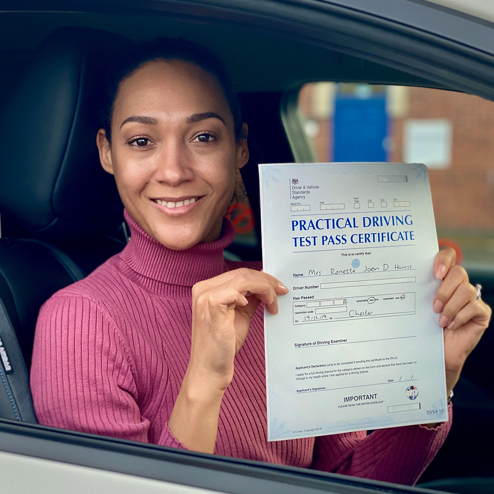 Successful driving test candidate with pass certificate