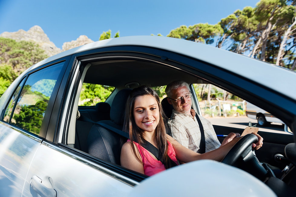 Learner driving car with instructor