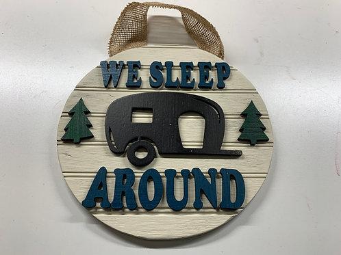 SM Round We Sleep Around Camper Sign