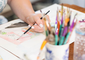 Artist, Rebecca Giese in her studio working on current watercolor collection. Hartsville, South Carolina