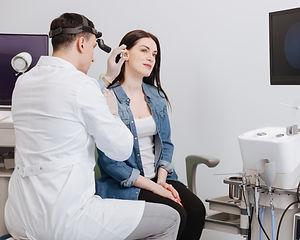 Ear nose throat doctor wearing headlight