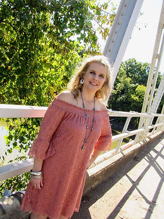 Kelly posing on old bridge