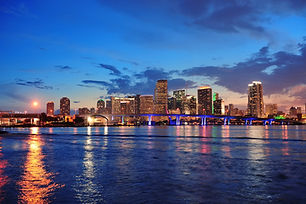 Miami city skyline panorama at dusk with