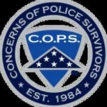 COPS+logo+PNG-148w.webp