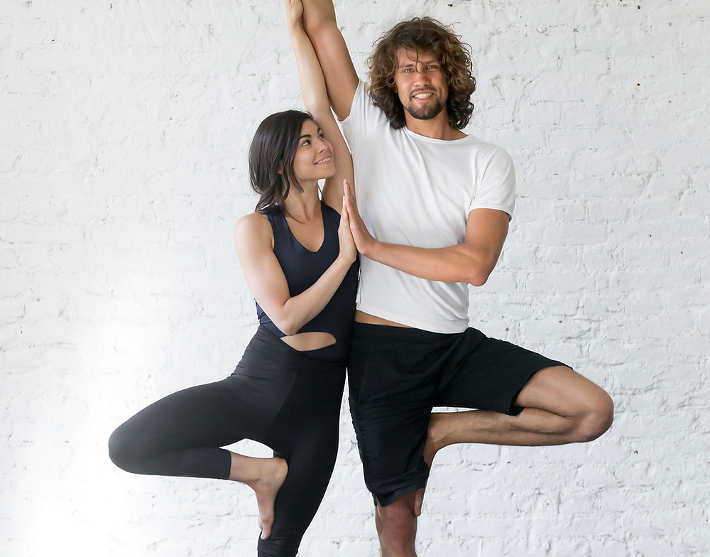 Couple practising yoga together