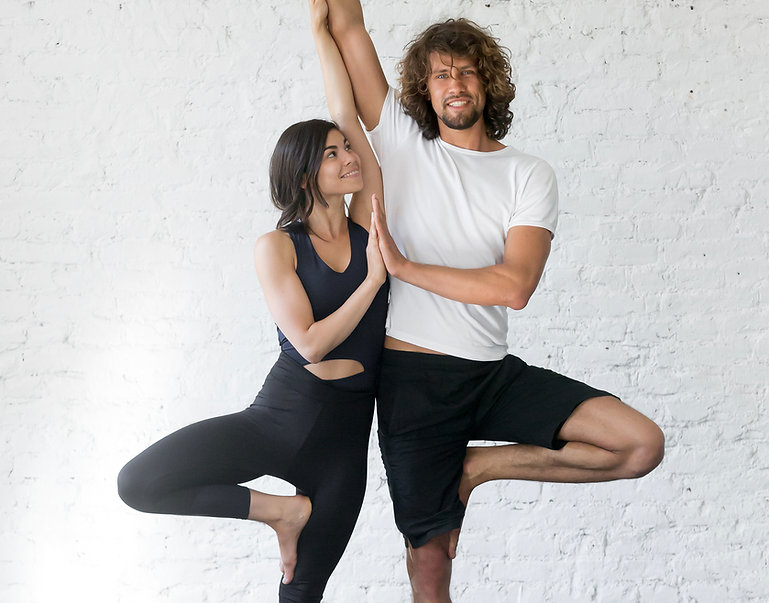 Couple Doing Yoga Pose