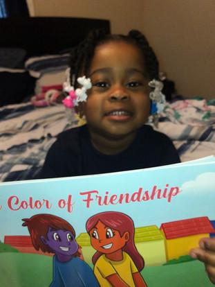 She loves her mom's book!