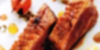 Hauptgericht Gänsebrust mit delikaten Gewürzperlen in Orangensauce
