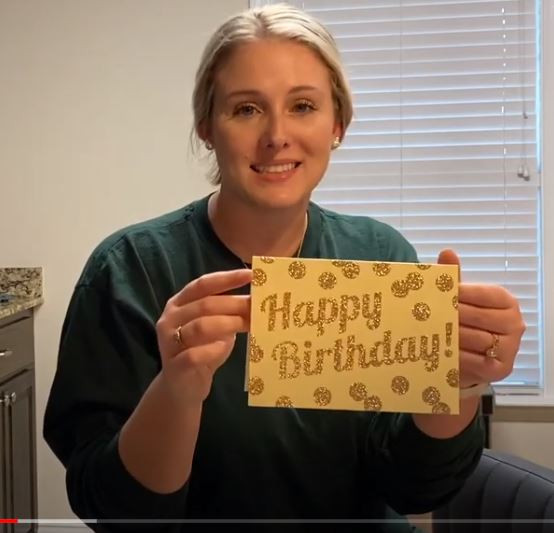 woman holding birthday card