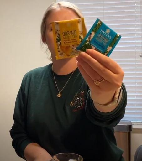 woman holding tea bags