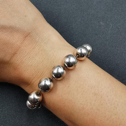 Silver bead bracelet.