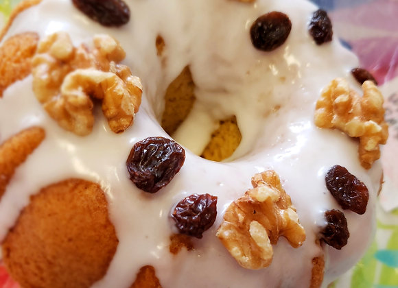 Pumpkin Cake with Raisins and Walnuts Covered with Lime