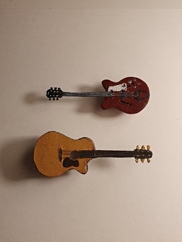 Two guitars made for a friend's birthday