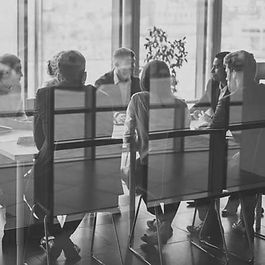 people sitting at a board table photo