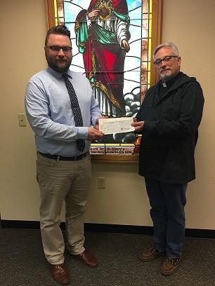 Adam Gitter and Father Mark Jones