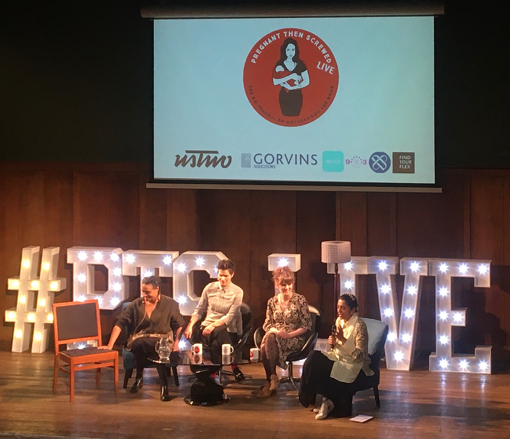 Four women onstage with #PTS Live sign behind them