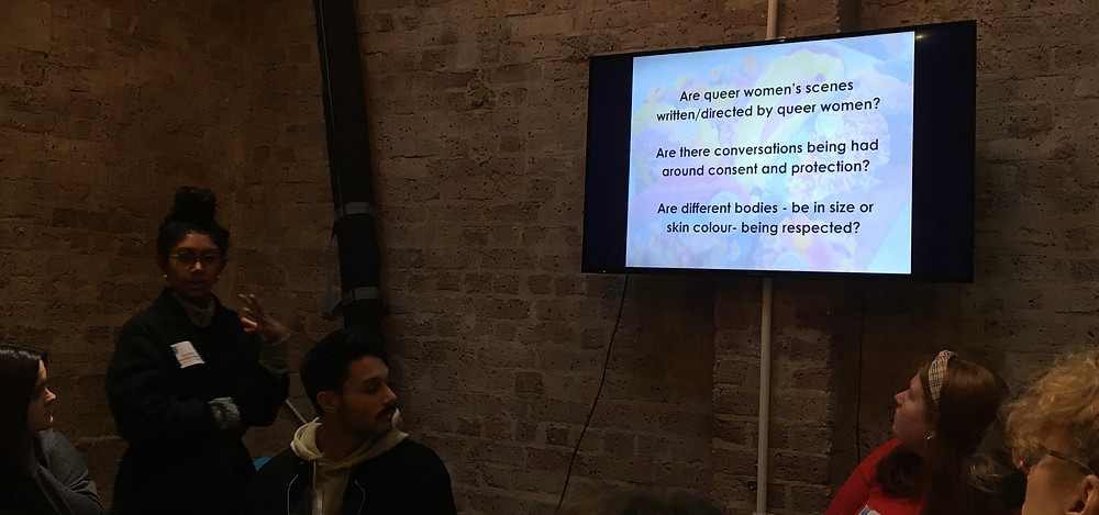 Sex educator Gayarithi Kamal in front of a screen with questions about queer women, consent, protection and diversity in porn