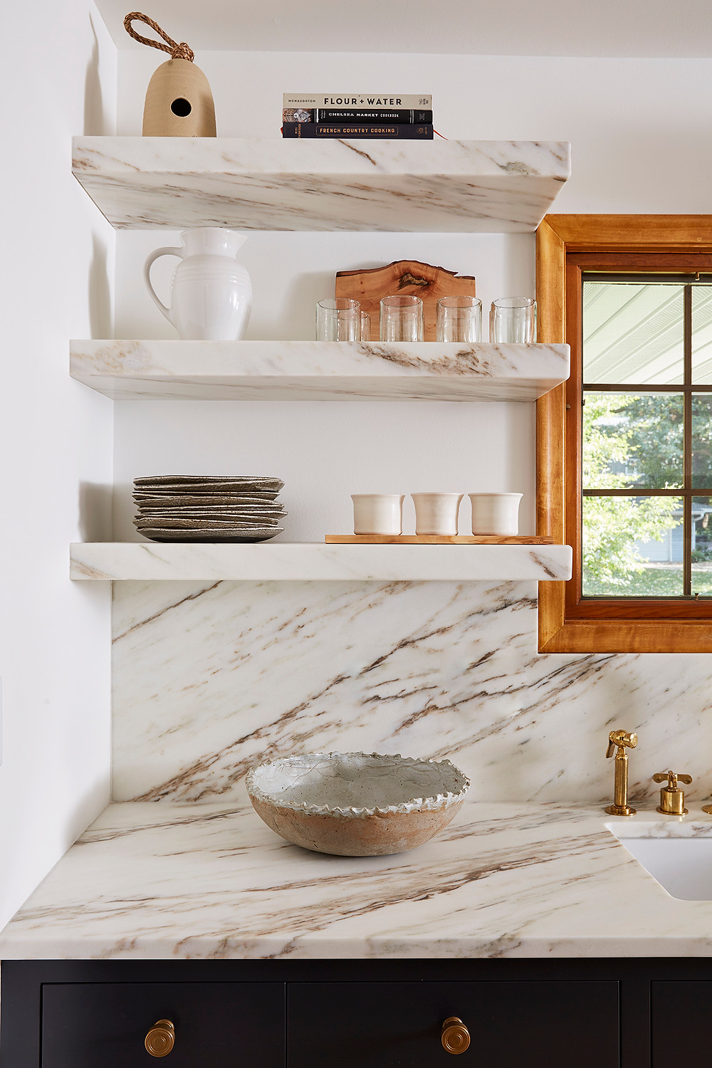 Custom Vermont Imperial Danby marble countertop, backsplash and floating shelves above custom inset cabinetry