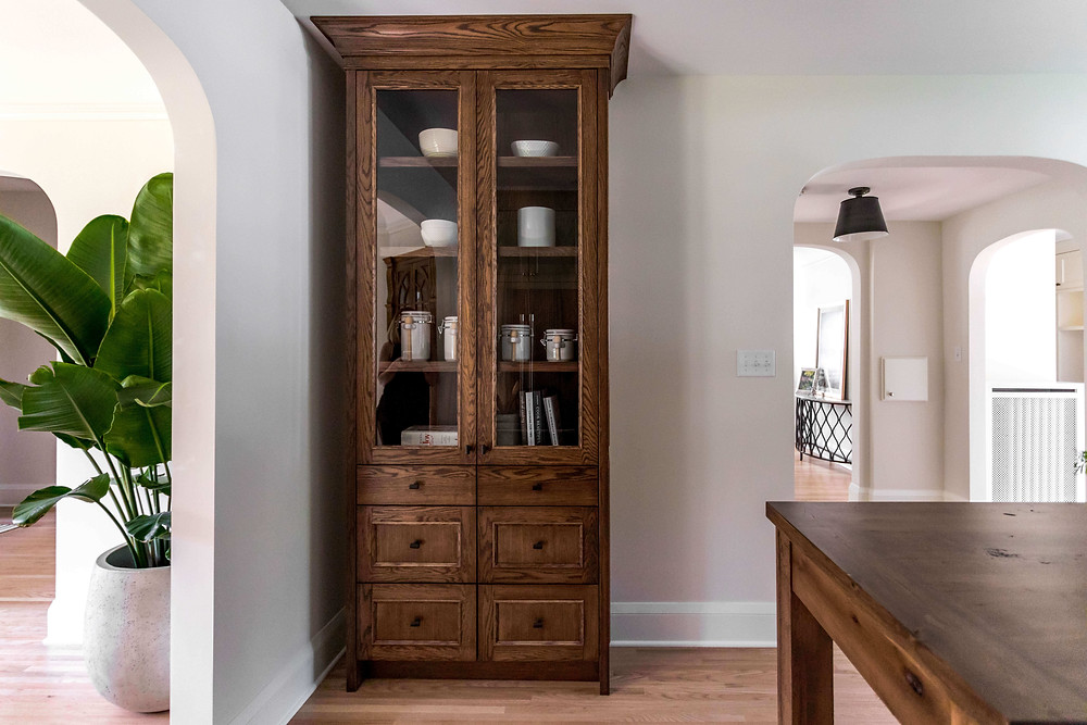 Charming custom hutch cabinetry in a modern Tudor kitchen renovation that looks like an heirloom piece of furniture
