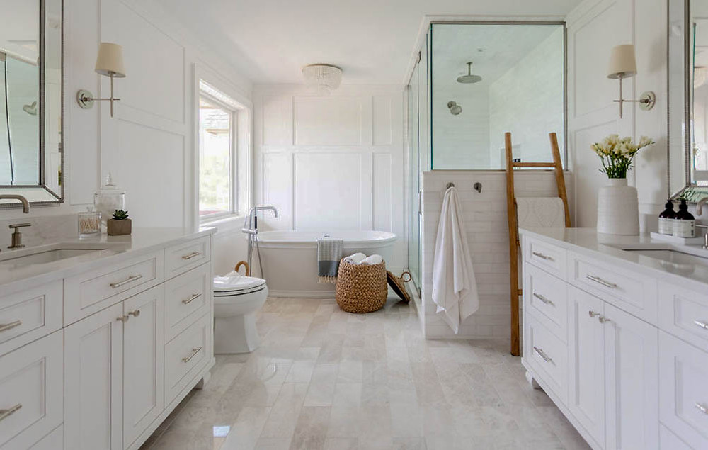 Elegant traditional owner's suite bathroom with separate double vanity, freestanding bathtub and walk in shower