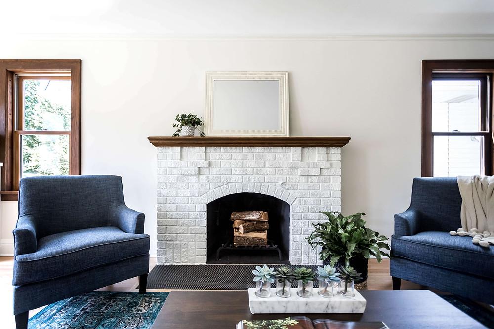 Painted white brick original fireplace in modern Tudor home renovation