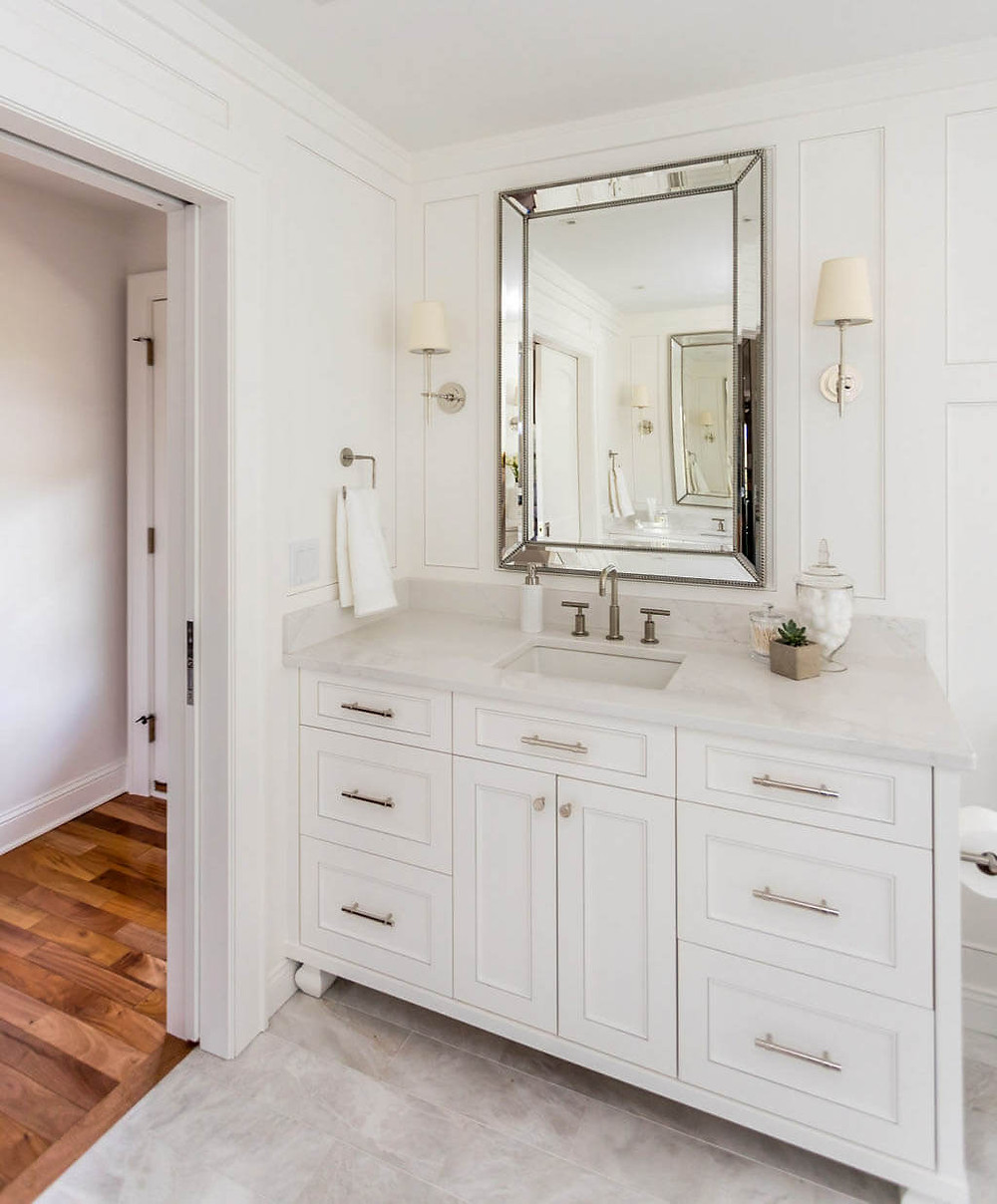 Custom traditional white painted vanity with elegant millwork
