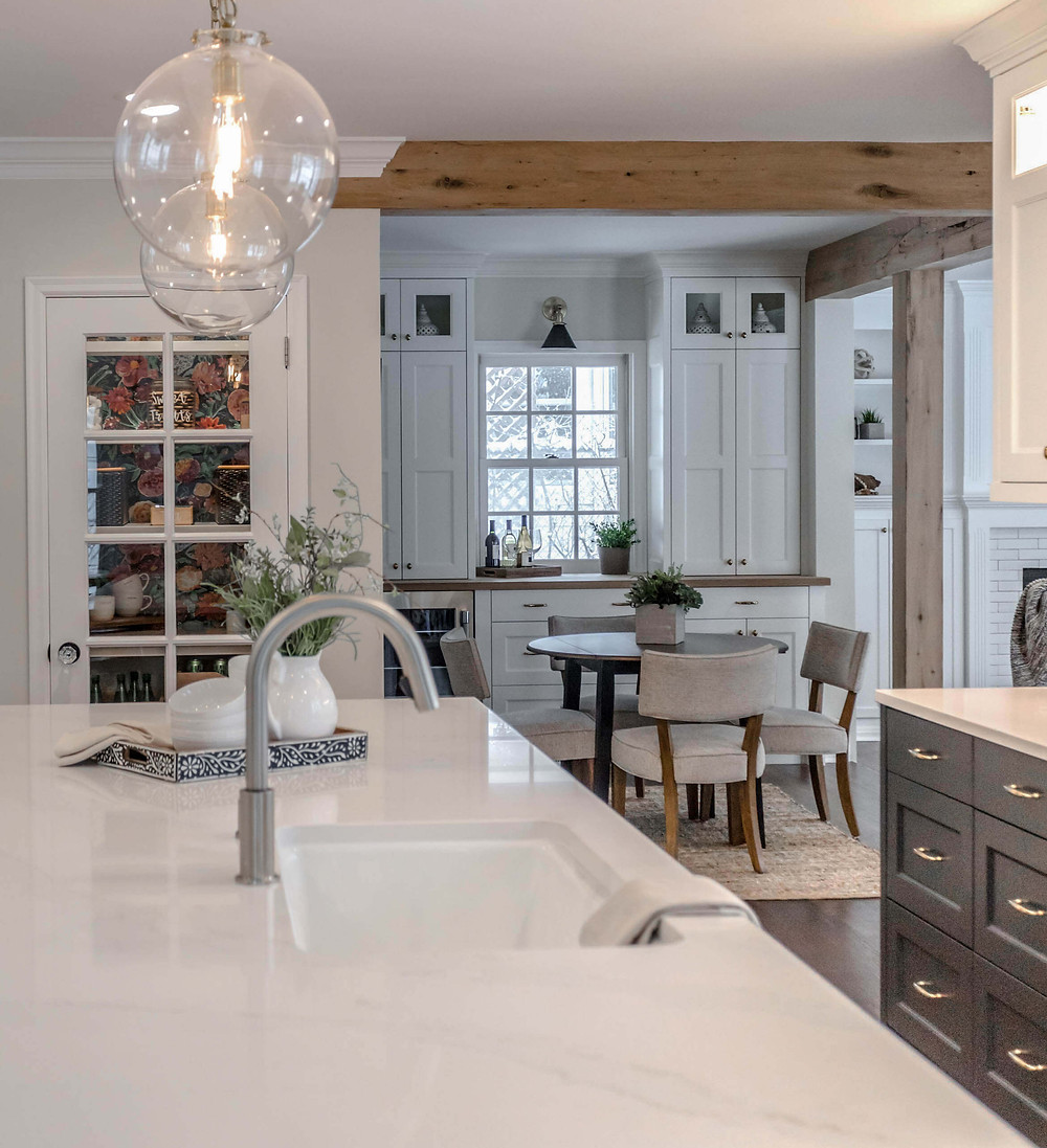 Kitchen with white quartz countertops, wallpaper pantry, reclaimed white oak beams and posts