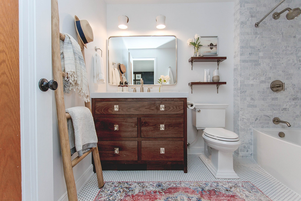 Custom inset walnut vanity with recessed cabinet pulls with shower bathtub and beautiful marble tile