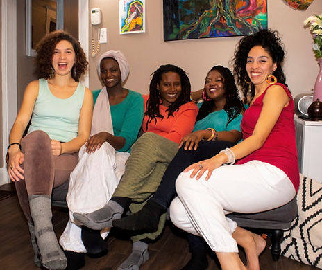 Ubuntu team seated with art in background, from left Hannah, Idel, Zhiizhii, Daphnée, and Elisha.