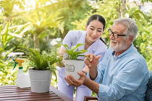 Caregiver help assist senior old man eld