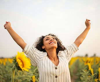 photo-of-woman-standing-on-sunflower-fie