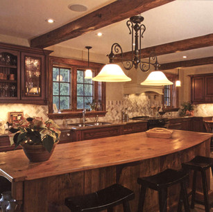 hand hewn ceiling beams & custom island