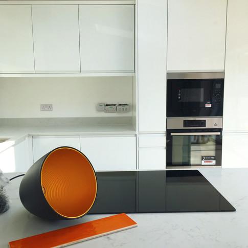Orange tiles, black and copper lamps
