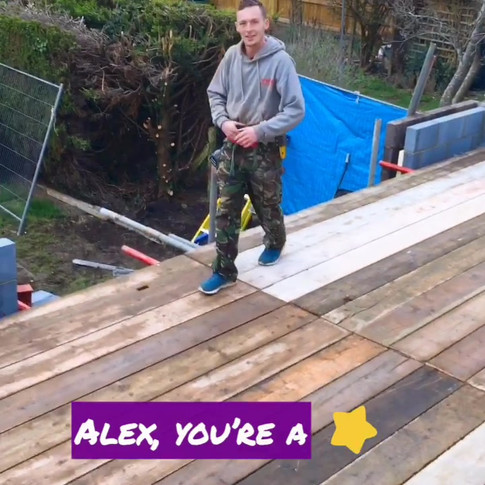 Alex performing on his scaff