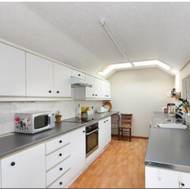 Long galley kitchen, window to right over sink