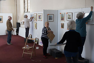 Hard at work hanging the exhibiton