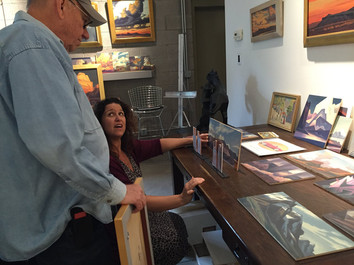 Reviewing Backdrop Renderings with Artist, Ed Mell, for 'Riders of the Purple Sage'